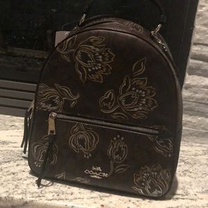 Chestnut with metallic flowers Coach back pack